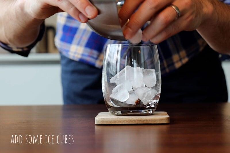 Adding ice cubes.
