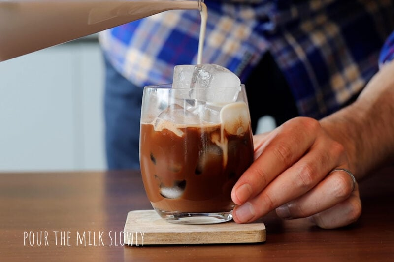 Pouring milk into the coffee
